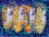 Inside of a gift box containing 4 bags of different flavors of gourmet popcorn.