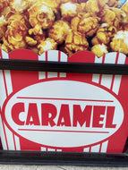 Caramel sign on the front of the store