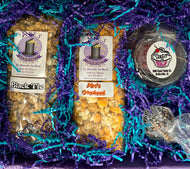 Sample of the inside of gift box with 2 bags of gourmet popcorn and 2 hot coco bombs