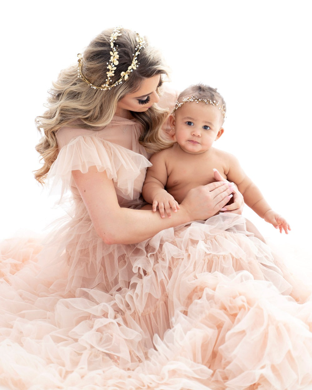 mother holding baby and wearing christie lauren headpeices