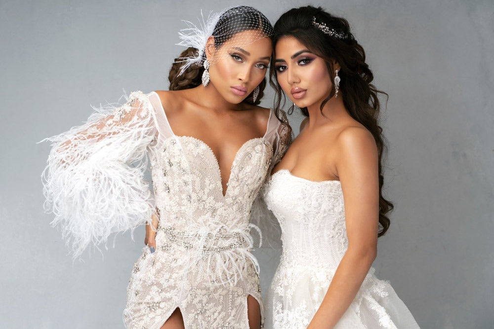 two brides wearing christie lauren bridal headpieces and jewelry