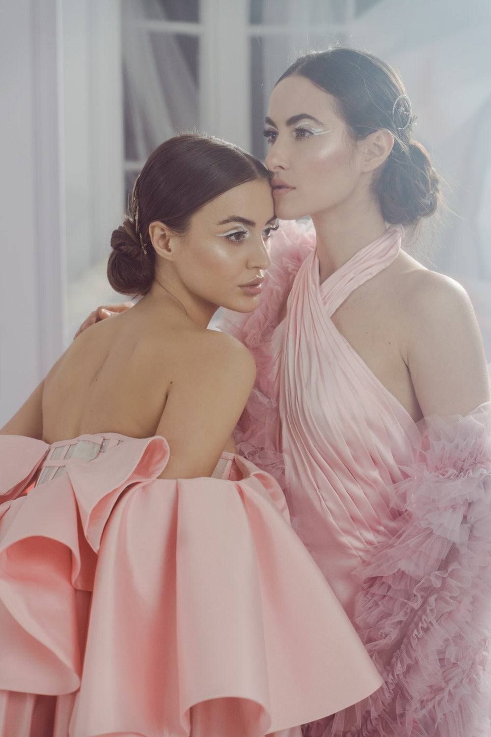 two women wearing pink gowns and christie lauren designs