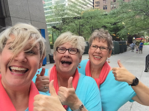 Three Duggan Sisters give thumbs up on windy Chicago street after winning Metro Chicago Export award