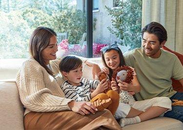 young family sitting on couch