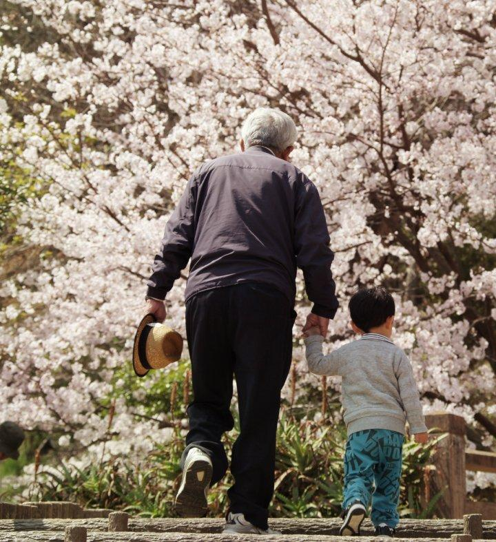 grandfather and grandson walking outside