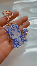 Load and play video in Gallery viewer, Baby Snow Leopard Acrylic Keychain