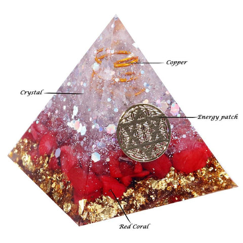 Orgonite pyramid crafted with white crystal, red coral, and resin.