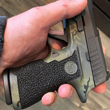 gambit stippling pattern on a sig sauer p320 by integral defense group