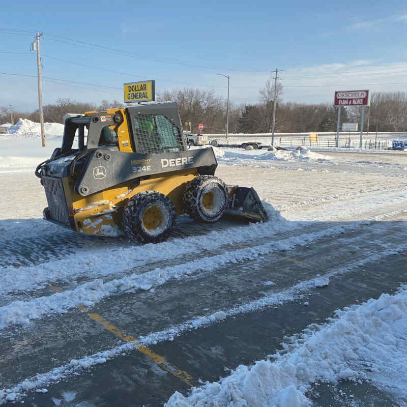 Skidsteer Clearing a Parking Lot