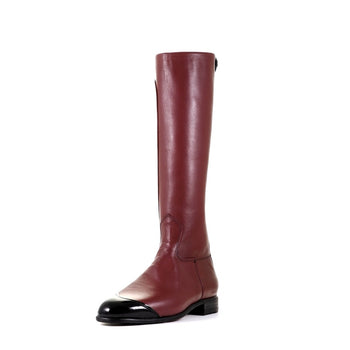 Exercise boots in burgundy for professional horse racing jockeys