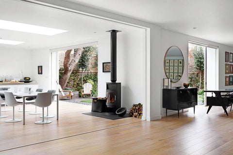 Open concept living room with a large circular mirror