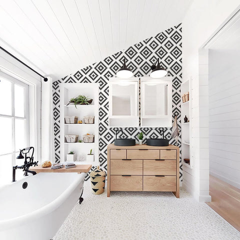 white bathroom with black and white geometric wallpaper