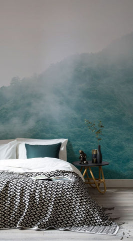 luxurious bed with a forest mural on the wall