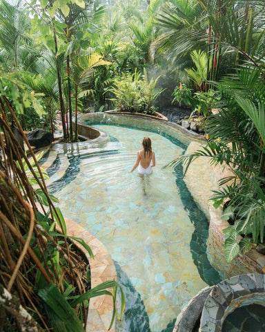woman swimming in a hot pool in the jungle