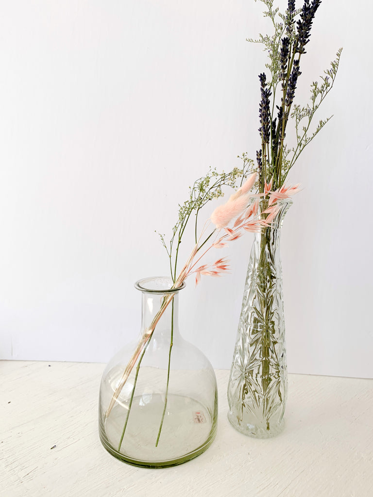 Clear vintage glass vases with dried flowers
