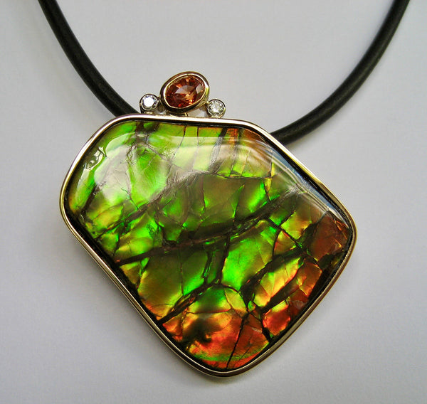 Susan Kun artwork 'GREEN/RED AMMOLITE, ORANGE SAPPHIRE & DIAMOND PENDANT' available at Canada House Gallery - Banff, Alberta