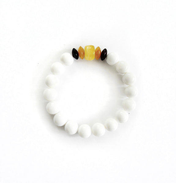 NESHKA artwork 'AMBER AND SHELL BRACELET' available at Canada House Gallery - Banff, Alberta