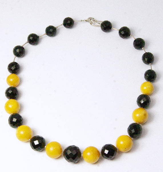 NESHKA artwork 'FACETED CHERRY & ANTIQUE MILKY AMBER NECKLACE' available at Canada House Gallery - Banff, Alberta
