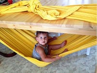 Kids will love creating a hammock den