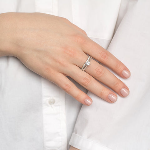 lady wearing wedding and engagement ring