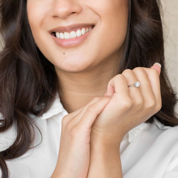 lady wearing platinum coloured engagement ring with birds