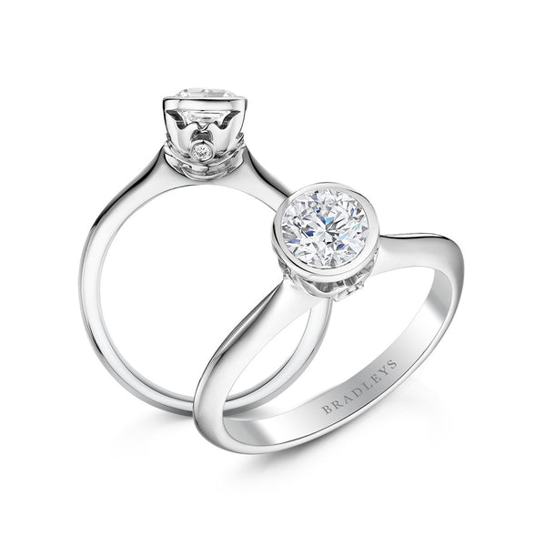 platinum coloured engagement ring with birds