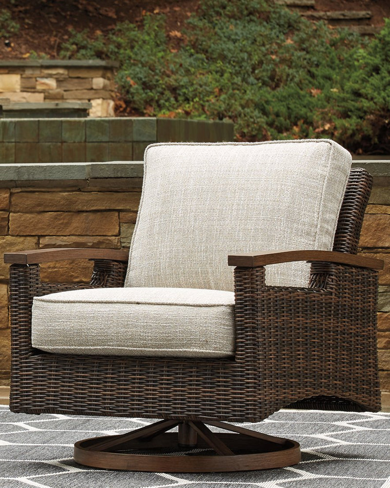 Paradise Trail Signature Design by Ashley Medium Brown Swivel Lounge Chair Set of 2