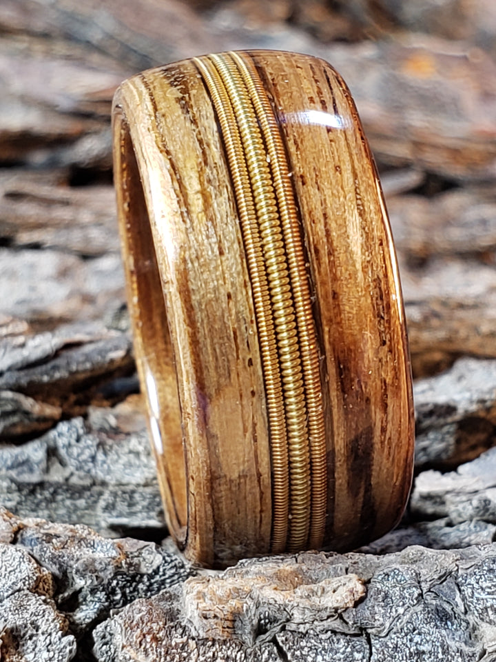 "DAD ring, Zebra wood steam bent wood ring with center inlay of 3 guitar strings ""D""""A""""D"" strings in brass and copper"