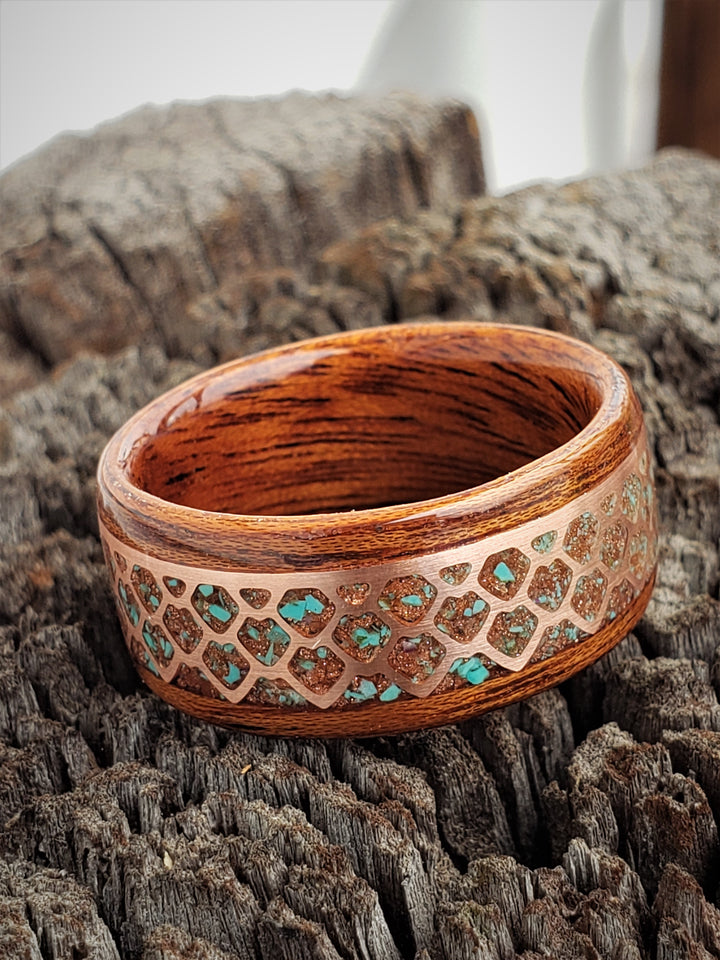 Copper Dragon scales filled with gold stone and turquoise set in a figured sapele steam bent wood ring