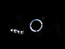 Load image into Gallery viewer, ANZO 1994-2001 Dodge Ram Projector Headlights w/ Halo Black