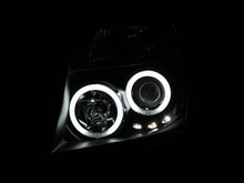 Load image into Gallery viewer, ANZO 2005-2008 Nissan Frontier Projector Headlights w/ Halo Black
