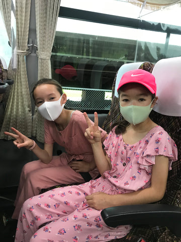 Arisa and Reina on the shuttle bus