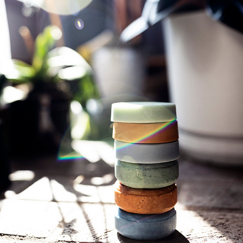 Image of solid shampoo and conditioner bars