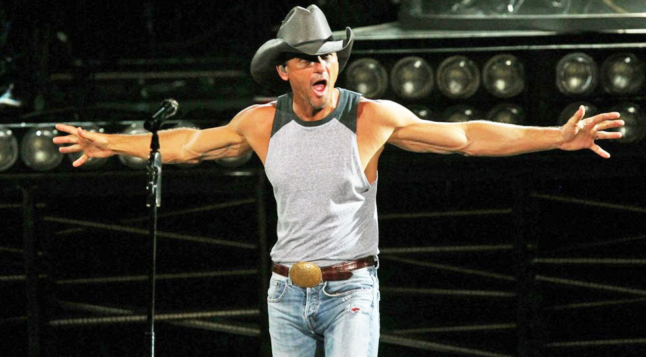 Watch Tim McGraw Almost 'Eat It' While Sledding In His Backyard | Country Music Videos
