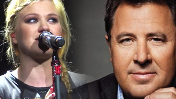 Vince gill Songs | Kelly Clarkson Pours Her Heart Out Singing Vince Gill's 'Go Rest High On That Mountain' | Country Music Videos