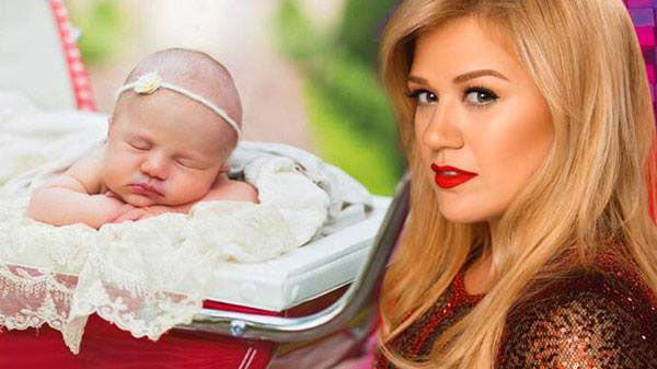 Kelly clarkson Songs   New Mom Kelly Clarkson Debuts 'Heartbreak Song' Official Video   Country Music Videos