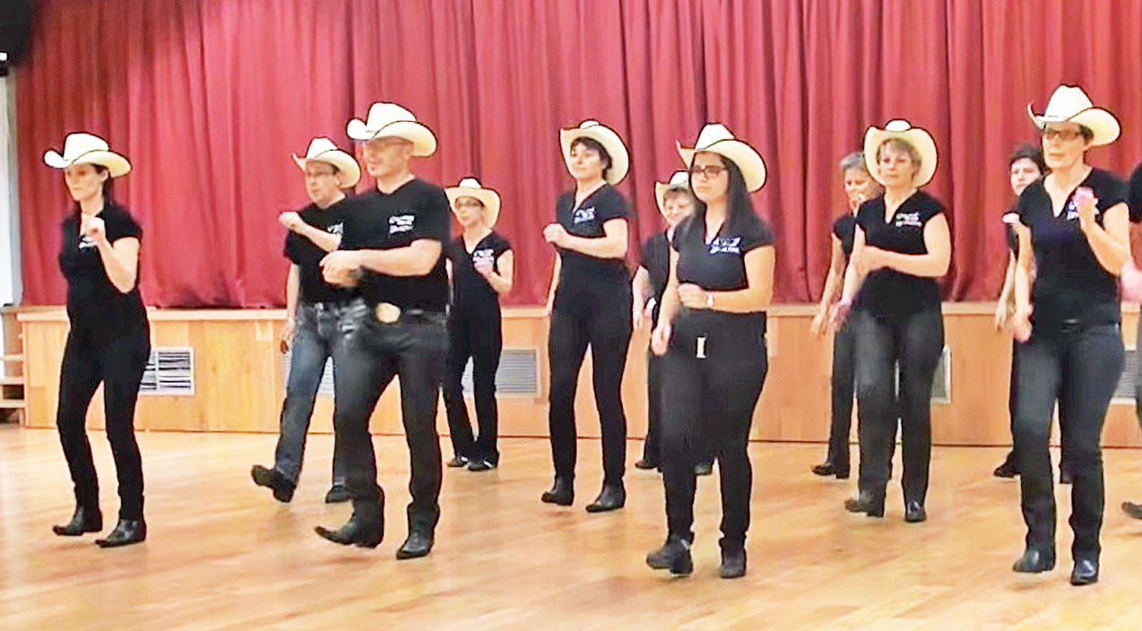 Modern country Songs   Line Dance Team Struts Their Stuff With Kenny Chesney Themed Routine   Country Music Videos