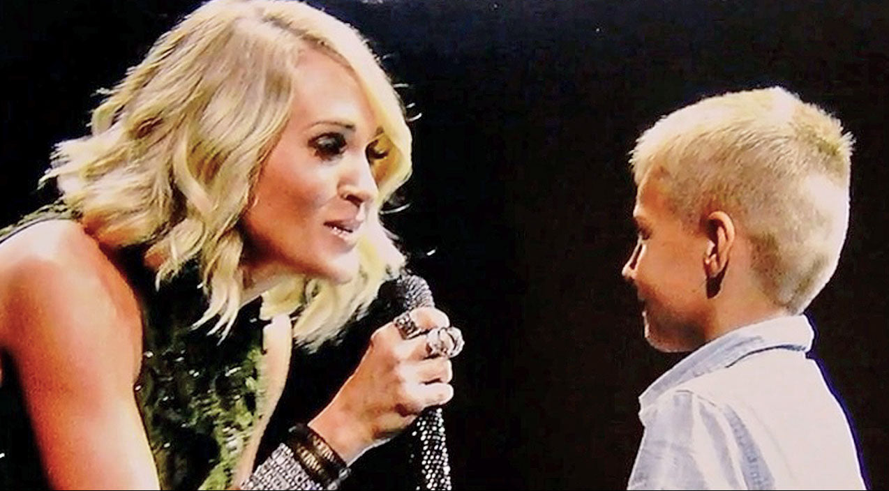 Modern country Songs | Carrie Underwood Kindly Invites Remarkable Little Boy On Stage To Sing With Her | Country Music Videos