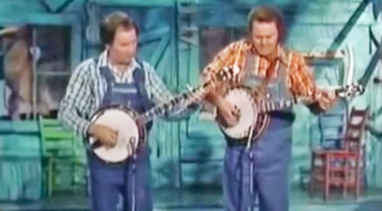 Roy clark Songs | Roy Clark & Buck Trent Tear Up The Stage In Epic 'Dueling Banjos' Battle | Country Music Videos