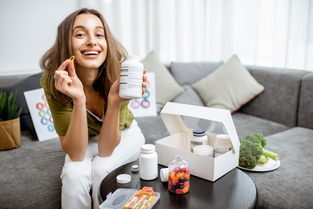 Woman with nutritional supplements at home