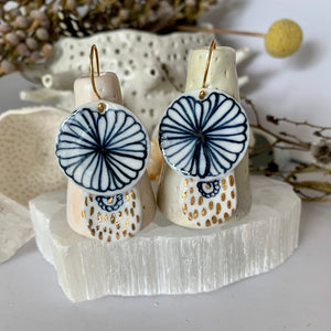 Blue and white hand painted porcelain earrings with gold lustre detail.