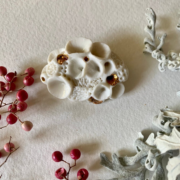 White and gold porcelain 'rock coral' brooch