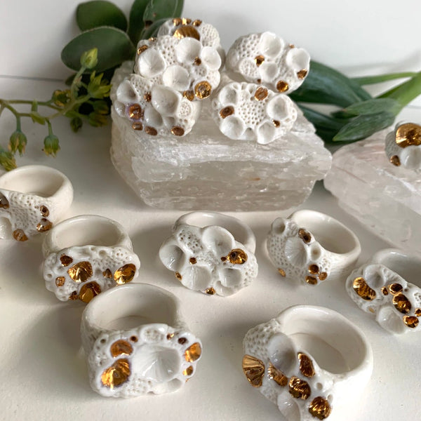 One white and gold 'rock coral' porcelain ring