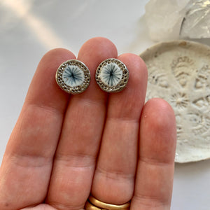 One pair of porcelain studs, blues
