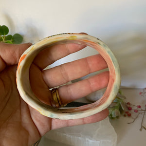 One  'stars and cells' porcelain bangle