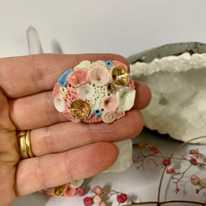 'Rock coral' coloured porcelain brooch, choose one