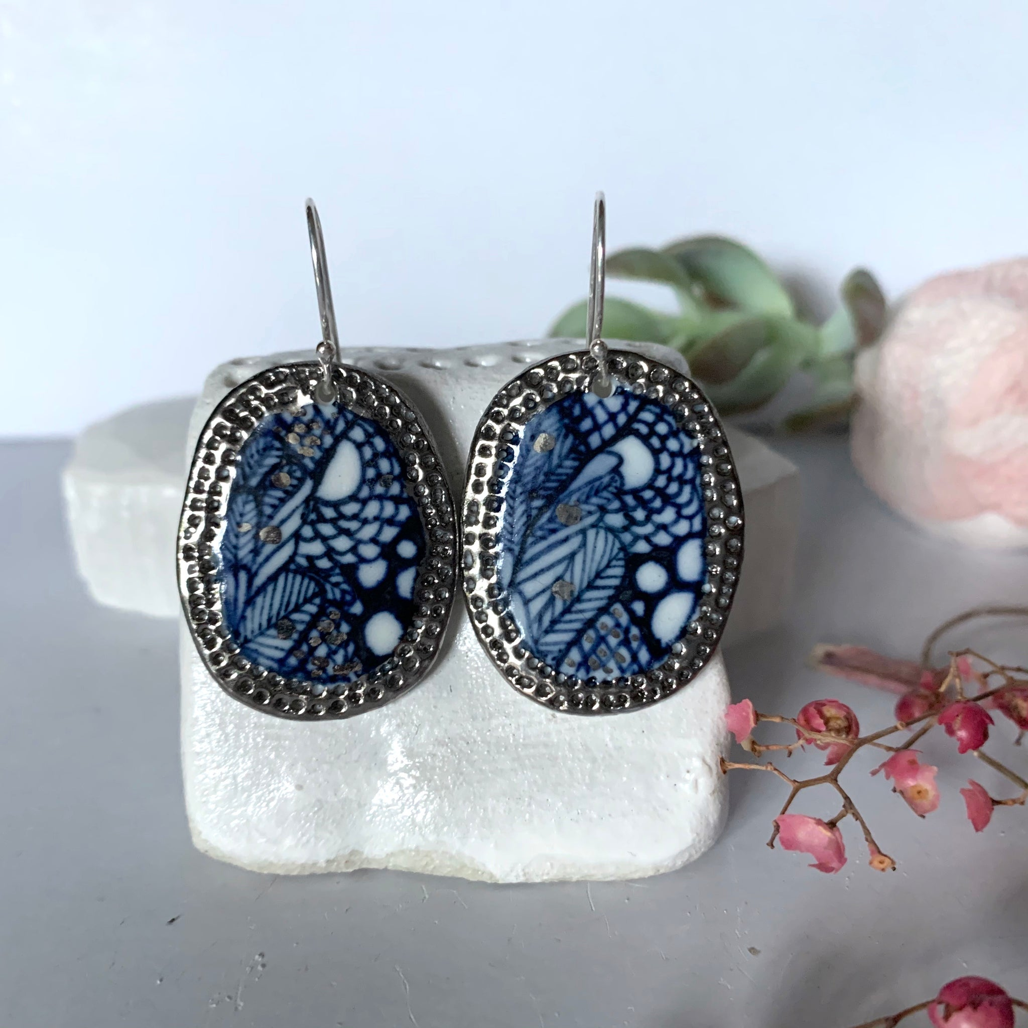 Oval 'sea foam' earrings with silver lustre border