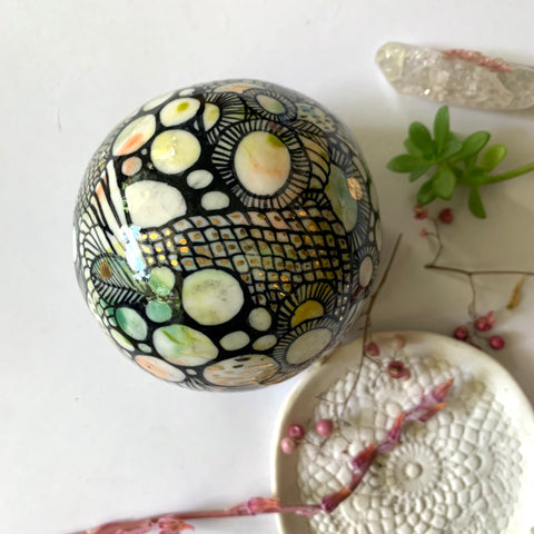 Hand painted porcelain paperweight with gold lustre details