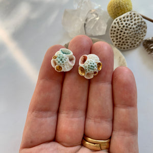 One pair of porcelain studs, watercolour coral