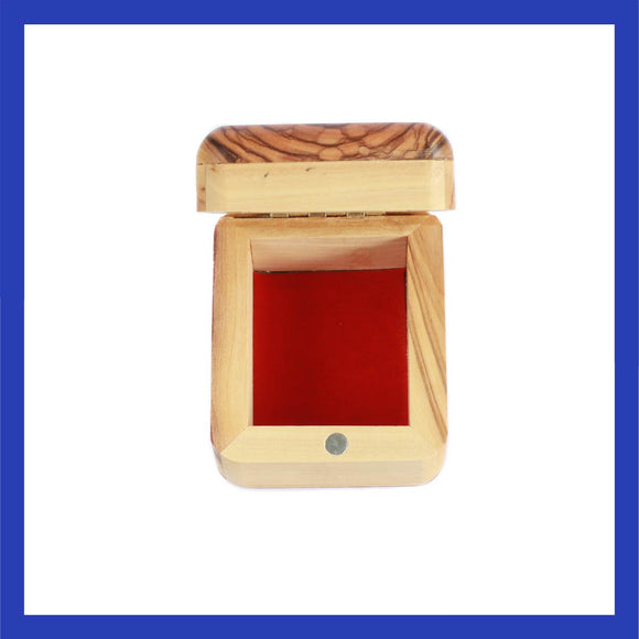Handmade Olive Wood jewelry box with red felt interior lining.